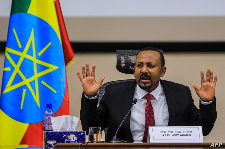Ethiopian Prime Minister Abiy Ahmed gestures at the House of Peoples Representatives in Addis Ababa, Ethiopia, on November 30,…
