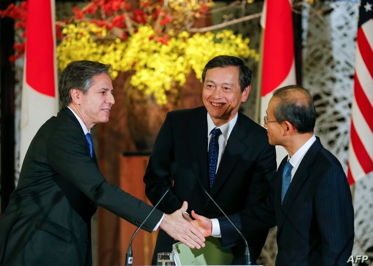 US Deputy Secretary of State Antony Blinken (L), Japanese Vice Foreign Minister Akitaka Saiki (C) and First Vice Minister of…