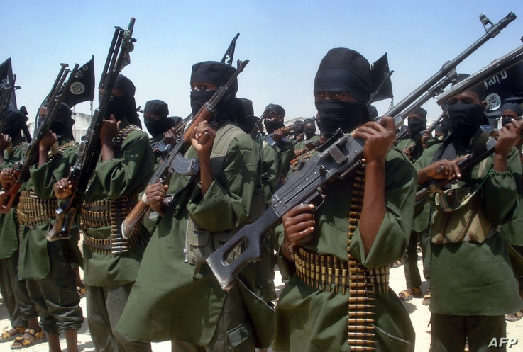 Islamist fighters loyal to Somalia's Al-Qaida inspired al-Shebab group perform military drills at a village in Lower Shabelle…
