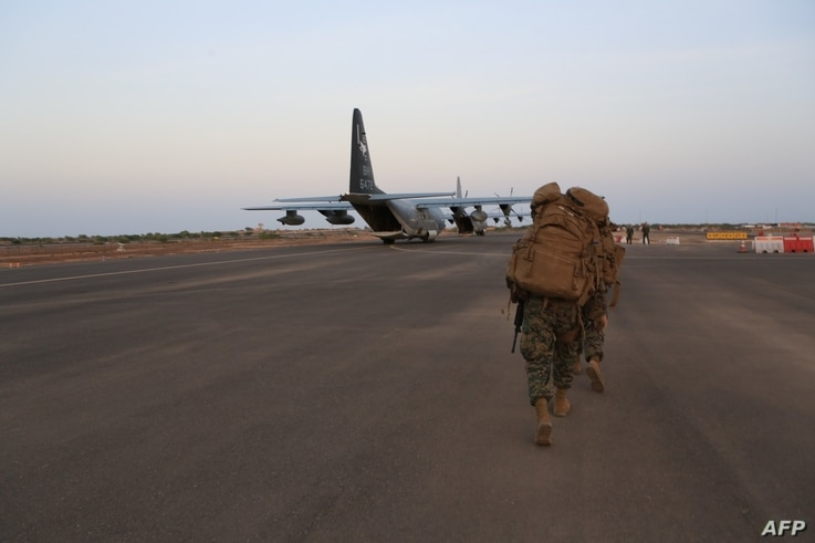 In this image released by the US Department of Defense, US Marines and sailors prepare to board a KC-130J Marine Super Hercules…
