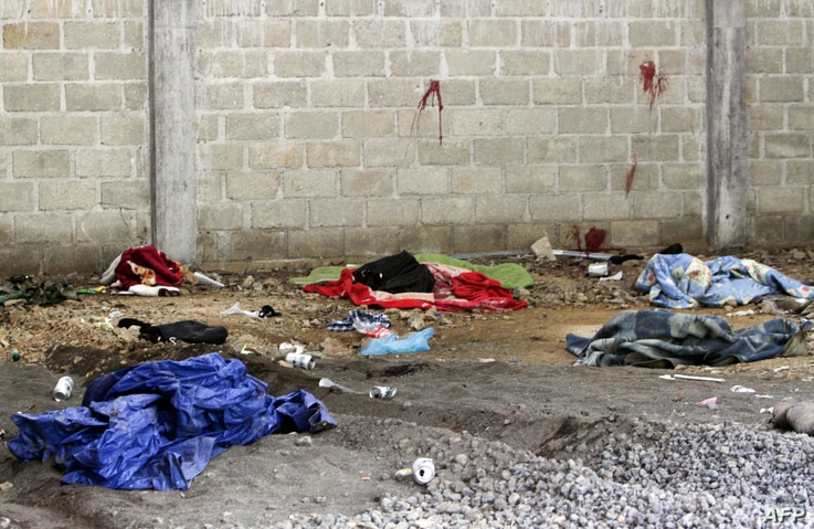 Blood is seen on the wall of a building in the Tlatlaya community after 22 people, alleged members of the Drug Cartel, were…