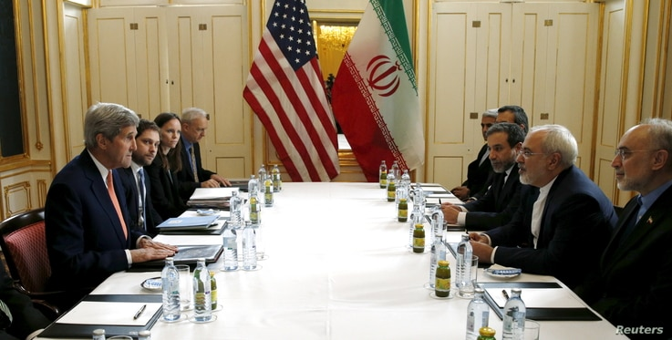 U.S. Secretary of State John Kerry (L) meets with Iranian Foreign Minister Mohammad Javad Zarif on what is expected to be …