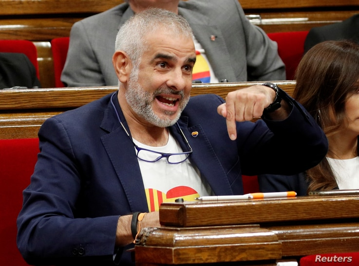 Carlos Carrizosa of Ciudadanos party speaks at the Parliament of Catalonia after Spain's Supreme Court jailed nine separatist…