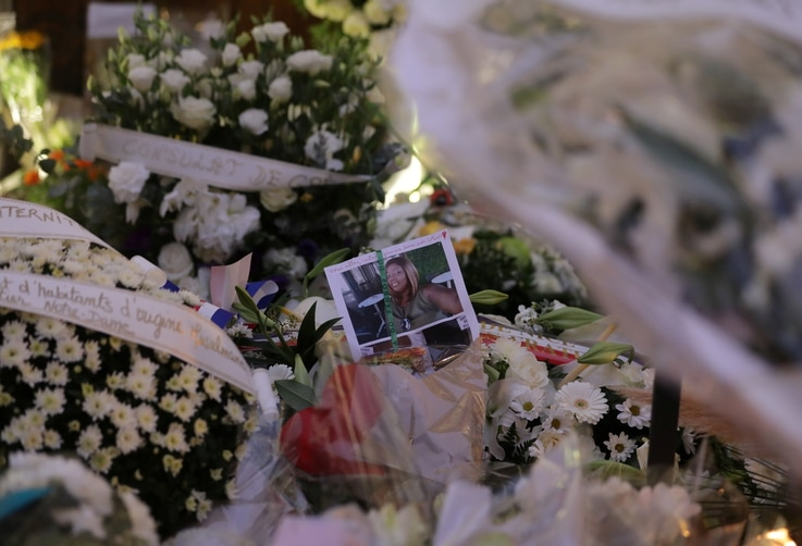 Portrait of a deadly knife attack victim is seen among flowers in front of the Notre Dame church in Nice, France, October 31,…
