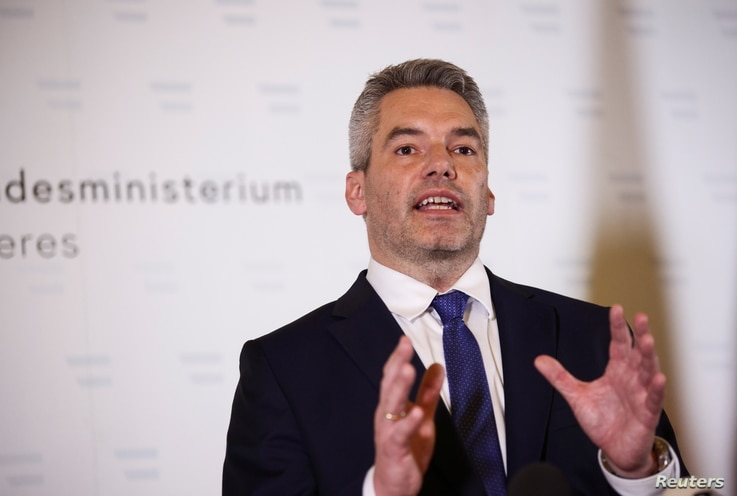Austria's Interior Minister Karl Nehammer speaks during a news conference at the Interior Ministry after exchanges of gunfire…