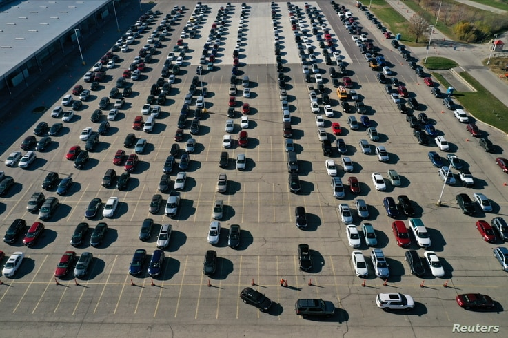 An aerial view of vehicles queuing at a drive-thru COVID-19 testing site in Madison, Wisconsin.