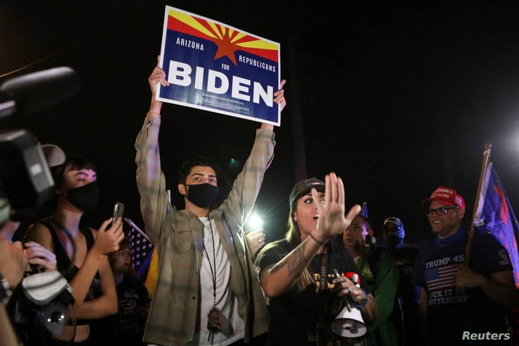 A supporter of U.S. President Donald Trump defends the right of a presidential nominee Joe Biden supporter
