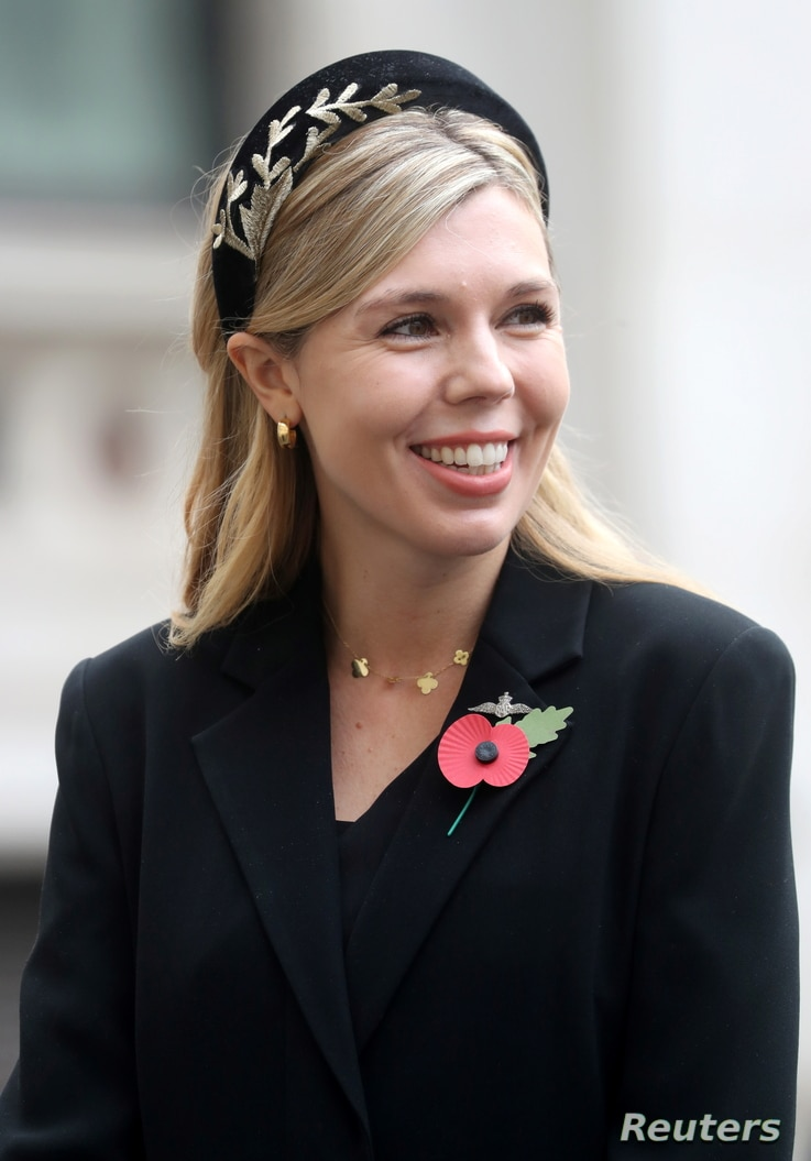 Carrie Symonds, partner of Britain's Prime Minister Boris Johnson meets veterans during the National Service of Remembrance at…