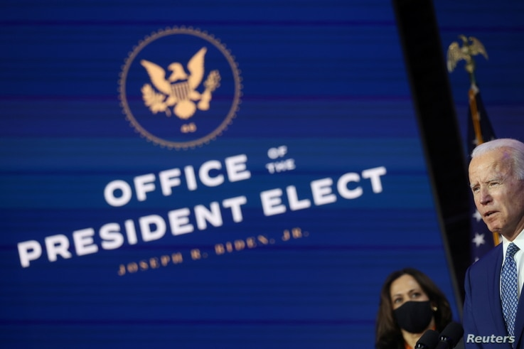 U.S. President-elect Joe Biden and Vice President-elect Kamala Harris face reporters after meeting with members of their…