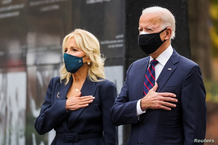 U.S. President-elect Joe Biden, accompanied by his wife Jill, attends a Veterans Day observance in Philadelphia, Pennsylvania, U.S., Nov. 11, 2020.
