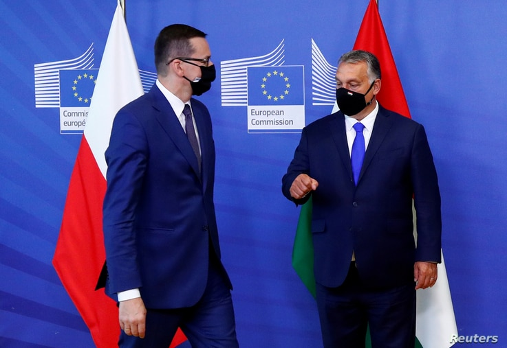 FILE PHOTO: Poland's Prime Minister Mateusz Morawiecki and Hungary's Prime Minister Viktor Orban arrive ahead of a meeting with…