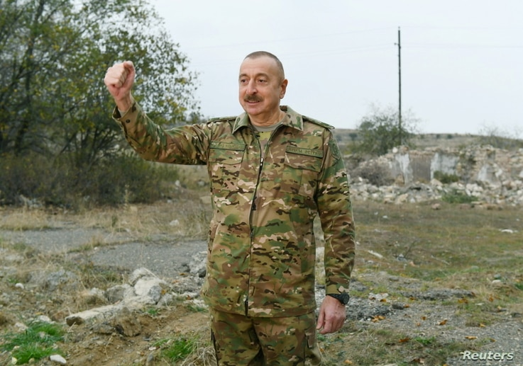 Azerbaijan's President Ilham Aliyev addresses the media as he visits Fuzuli and Jabrayil districts in the region of Nagorno…