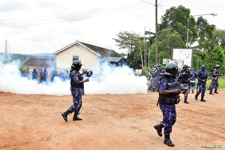 Ugandan riot policemen fire tear gas canisters to disperse supporters of presidential candidate Robert Kyagulanyi, also known…