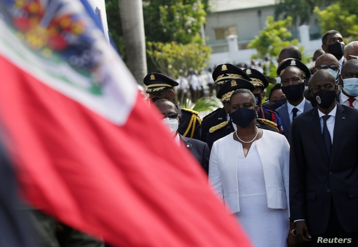 Haiti's President Jovenel Moise (R) and First Lady Martine Moise attend celebrations in Port-au-Prince, Haiti.