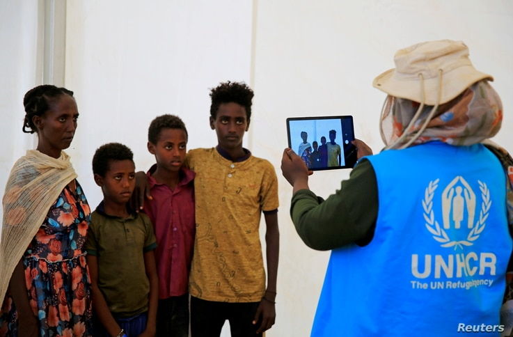 A humanitarian worker from UNHCR, documents Ethiopian refugees fleeing from the ongoing fighting in Tigray region, at the Um…