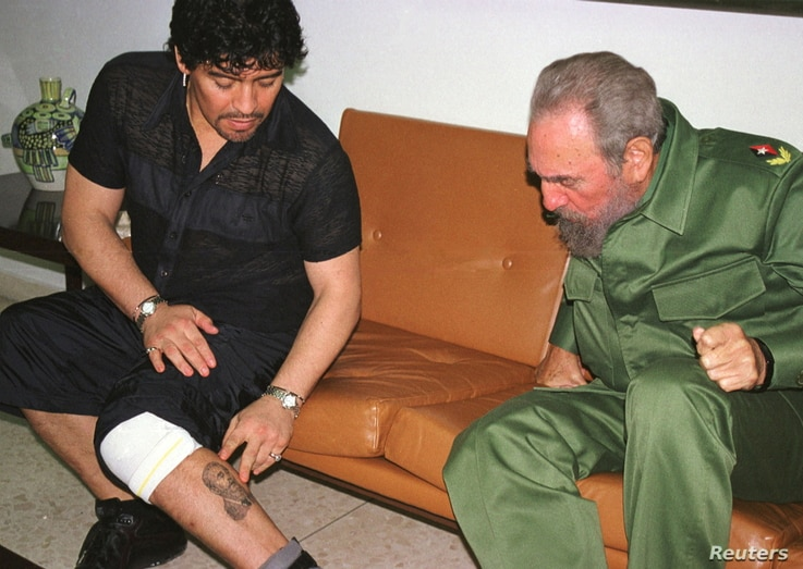 FILE PHOTO: Argentine soccer legend Diego Maradona, then in Cuba undergoing rehabilitation for cocaine abuse, shows Cuban…