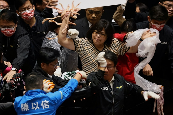 Taiwan lawmakers throw pork intestines at each other during a scuffle in the parliament in Taipei, Taiwan, November 27, 2020…