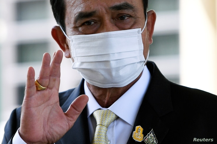 Thailand Prime Minister Prayuth Chan-ocha waves as he attends an agreement signing ceremony for purchase of AstraZeneca's potential COVID-19 vaccine at Government House, amid the spread of the coronavirus disease (COVID-19), in Bangkok, Nov. 27, 2020.