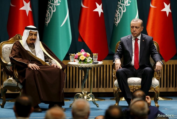 FILE PHOTO: Turkey's President Tayyip Erdogan (R) and Saudi King Salman attend a ceremony in Ankara, Turkey April 12, 2016…