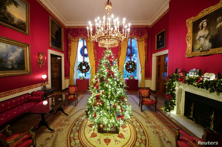 The Red Room of the White House is adorned with holiday decorations during a press preview in Washington, Nov. 30, 2020.