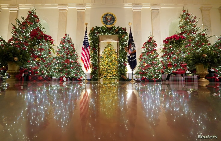 Holiday decor adorns the Cross Hall of the White House in Washington, Nov. 30, 2020.