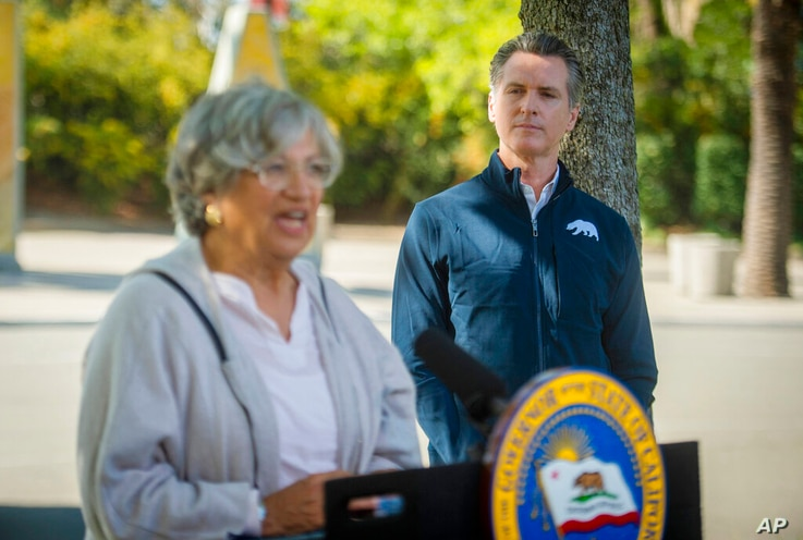 California Air Resources Board chair Mary Nichols, left, speaks as California Gov. Gavin Newsom listens at a press conference…