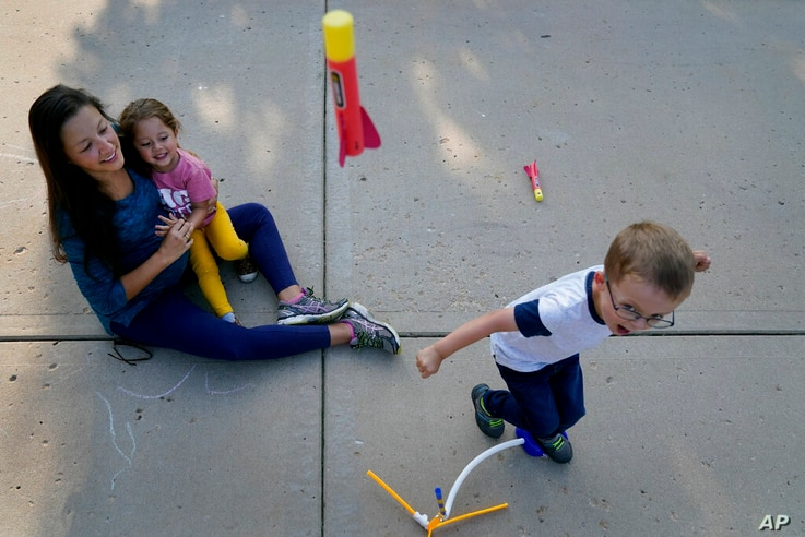 Claire Reagan plays with her kids Evan, 5, and Abbie, 3, Monday, Sept. 21, 2020, outside her home in Olathe, Kan. Reagan is…