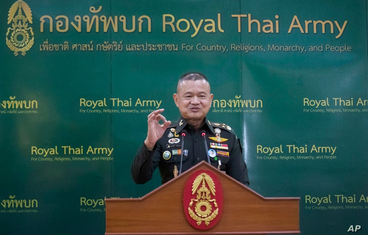 Thailand Army Chief Gen. Narongpan Jittkaewtae speaks during press briefing at the Thai Army headquarters in Bangkok, Thailand, Oct. 6, 2020.