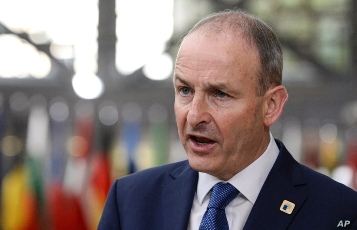 Ireland's Prime Minister Micheal Martin speaks with the media as he arrives for an EU summit in Brussels, Friday, Oct. 16, 2020…