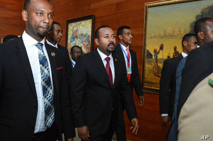 FILE - In this Sunday, Feb. 9, 2020, file photo, Ethiopia's Prime Minister Abiy Ahmed, center, arrives for the opening session…
