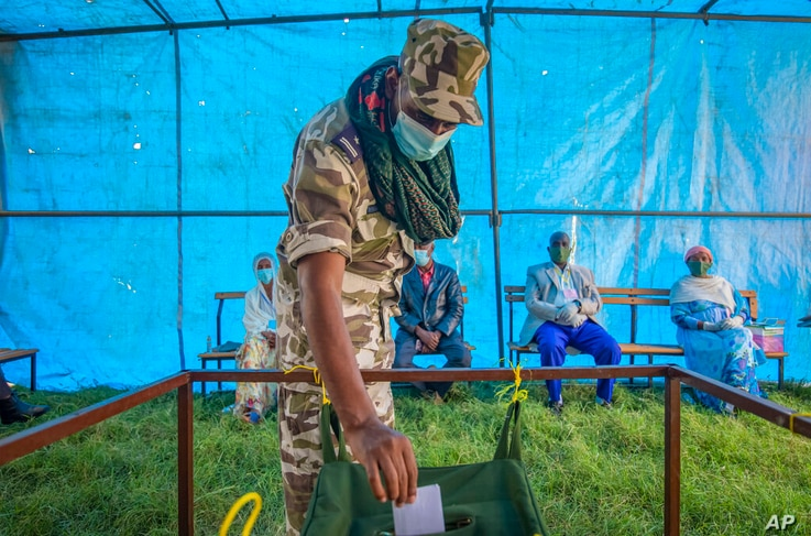 FILE - In this Sept. 9, 2020 file photo, a member of Tigray Special Forces casts his vote in a local election in the regional…