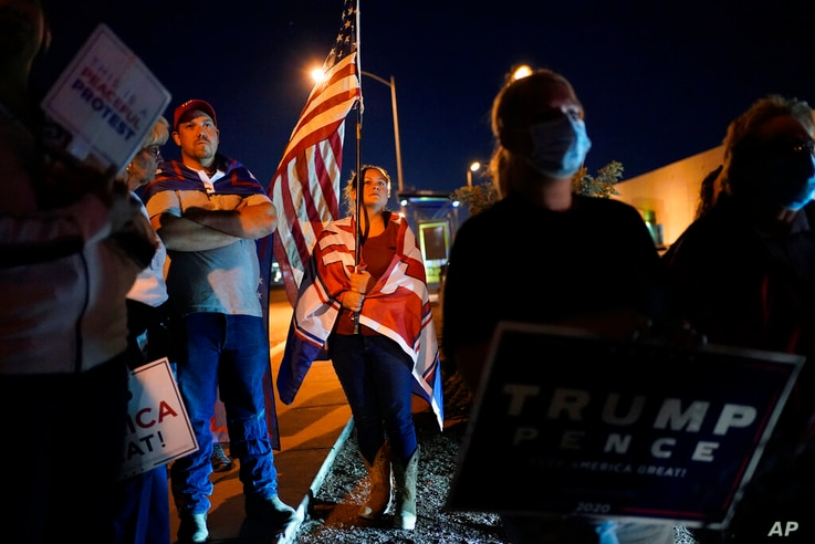 Supporters of President Donald Trump protest the Nevada vote in front of the Clark County Election Department, Wednesday, Nov…