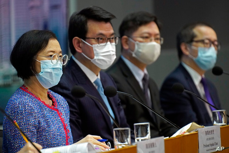 Secretary for Food and Health, Sophia Chan, left, and other officials attend a press conference in Hong Kong Wednesday, Nov. 11…