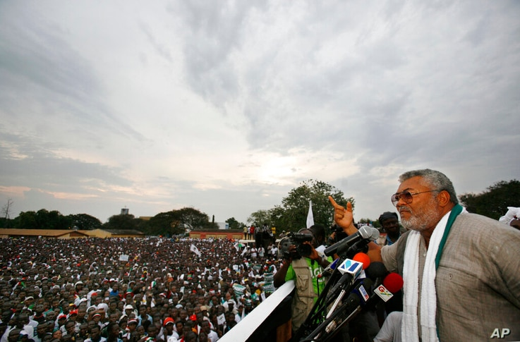 FILE - In this Friday, Dec. 5, 2008 file photo, former Ghanaian President Jerry Rawlings speaks at the final campaign rally for…