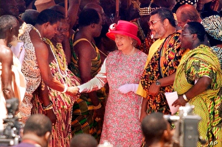 FILE - In this Monday, Nov. 8, 1999 file photo, Britain's Queen Elizabeth II, flanked to the right by Ghanaian President Jerry…