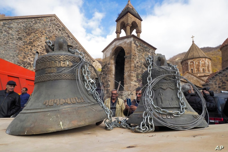 People look at bells, removed form the Dadivank, an Armenian Apostolic Church monastery dating to the 9th century, as ethnic…