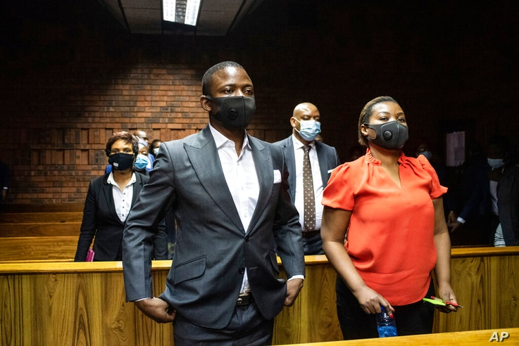 Self proclaimed prophet Shepherd Bushiri and his wife Mary, right, in the magistrates court in Pretoria, South Africa, Friday,…