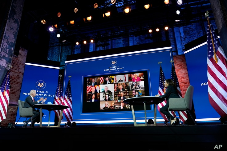 President-elect Joe Biden and Vice President-elect Kamala Harris participate in a meeting with the National Governors Association's executive committee at The Queen theater, Thursday, Nov. 19, 2020, in Wilmington, Del. (AP Photo/Andrew Harnik)