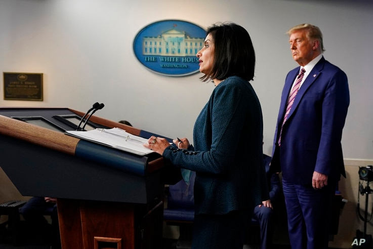 President Donald Trump listens as Administrator of the Centers for Medicare and Medicaid Services Seema Verma speaks during a…