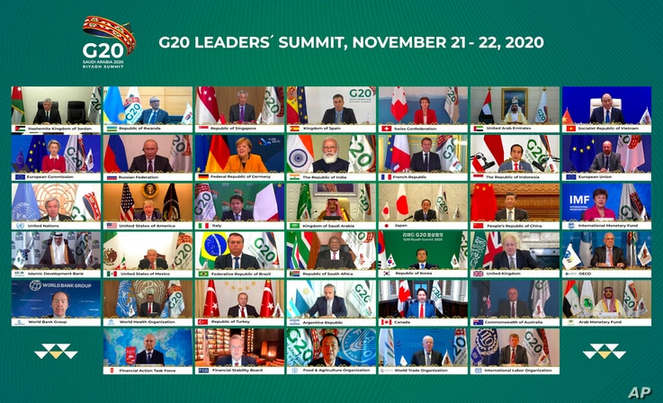 This handout photo provided by G20 Riyadh Summit, shows Saudi King Salman, center, and the rest of world leaders during a…