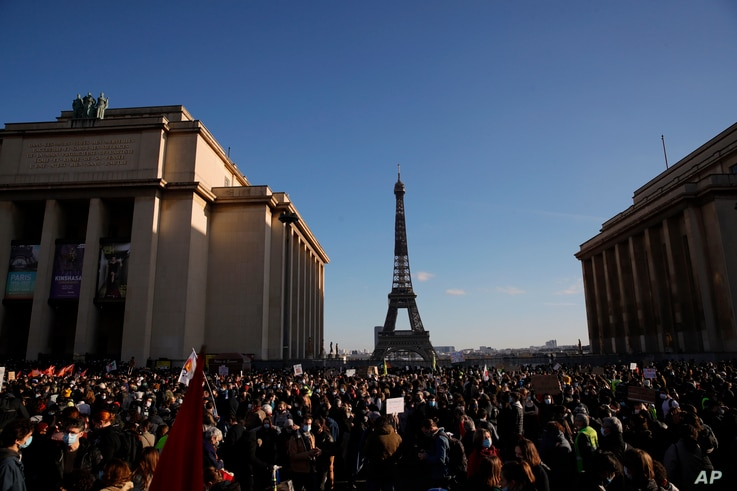 Demonstrators gather during a protest against bill on police images, in Paris, Saturday, Nov. 21, 2020. Thousands of people…