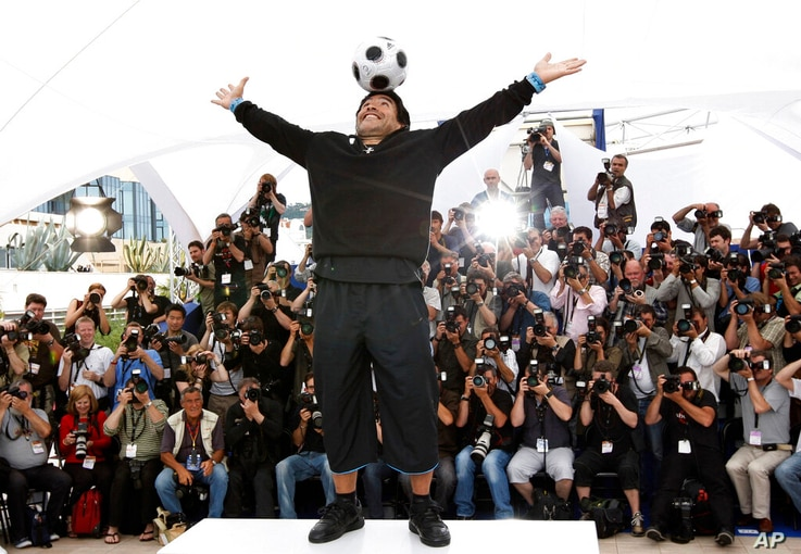 FILE - In this May 20, 2008 file photo former Argentine soccer player Diego Maradona poses during the photo call for the…