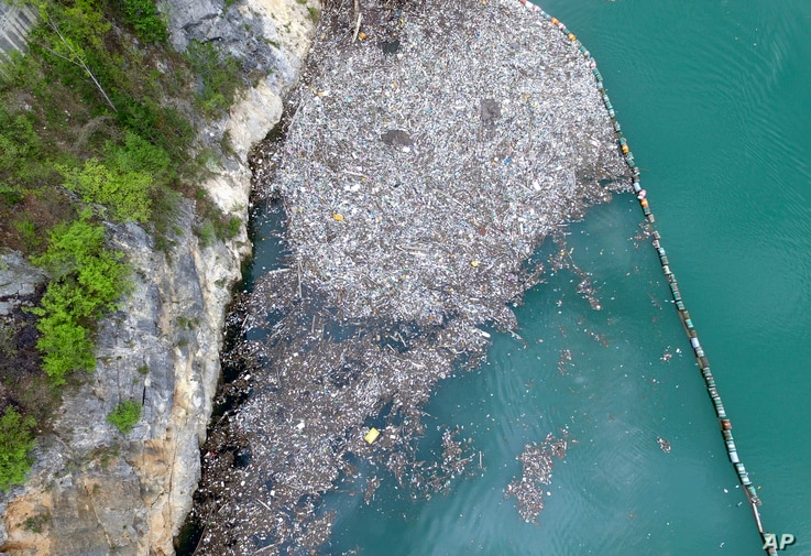 In this April 23, 2019 aerial photo, plastic bottles and other garbage float in river Drina near Visegrad, eastern Bosnia-Herzegovina. Hundreds of tons of garbage is floating in Bosnian rivers as reckless citizens and incompetent officials fail to keep the environment preserved in one of the most polluted countries of Europe. (AP Ph