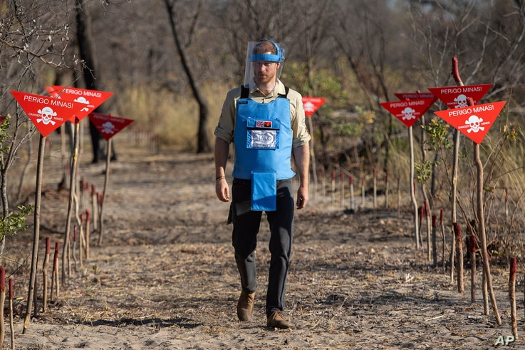 FILE - Britain's Prince Harry walks through a minefield in Dirico, Angola, during a visit to see the work of landmine clearance charity the Halo Trust, on day five of the royal tour of Africa, Sept. 27, 2019.