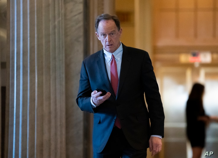 Sen. Pat Toomey, R-Pa., returns from a break in the impeachment trial of President Donald Trump on charges of abuse of power…