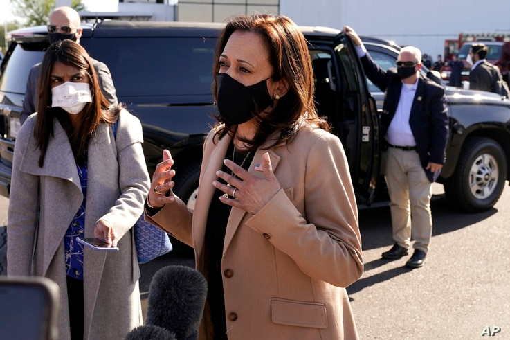 Democratic vice presidential candidate Sen. Kamala Harris, D-Calif., speaks to the media after arriving at Sky Harbor International Airport, Oct. 28, 2020, in Phoenix.