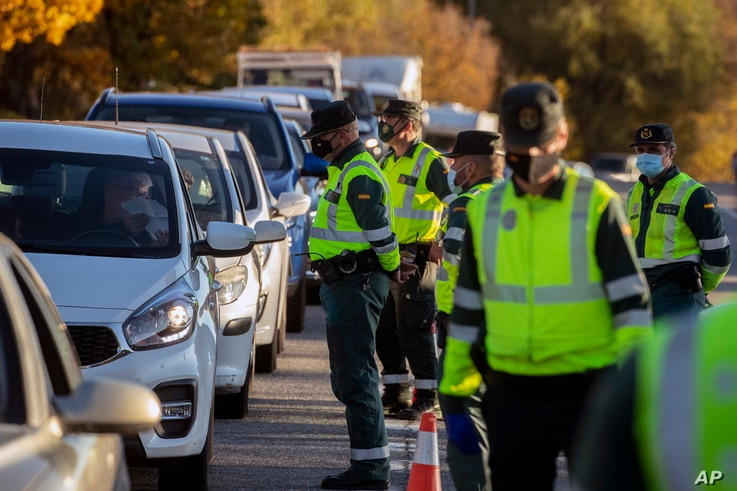 Guardia Civil officers stop vehicles at a checkpoint in Somosierra, Spain, Friday, Oct. 30, 2020. All Spanish regions except…