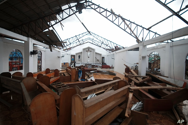 The roof and pews of the St. Francis of Assisi church in Malinao town are damaged from powerful winds of Typhoon Goni in Albay…