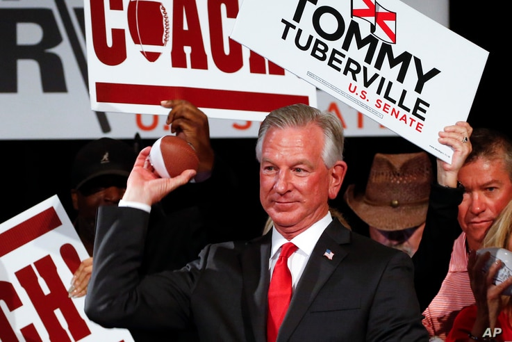 Republican Senator elect Tommy Tuberville throws footballs to supporters at his watch party at the Renaissance Hotel on Tuesday…