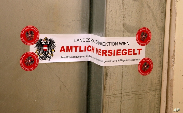 """The seal with the inscription """"State police department of Vienna, officially sealed"""" is pictured at a police door of a…"""